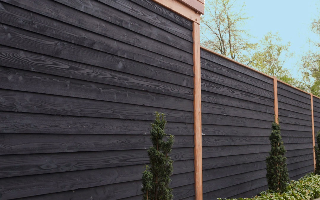Stain your fence black!